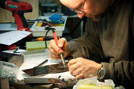Man with soldering iron